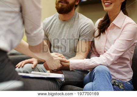 Closeup of young man and woman visiting couples counseling session