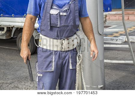 Lineman With Climbing Gear And Equipment