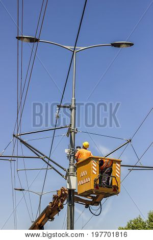 Lineworkers Work On Overhead Power Line