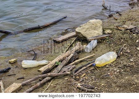 Plastic Bottles And Garbage Waste On The Shore