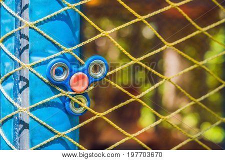 Finger Spinner On The Playground. Blurred Background