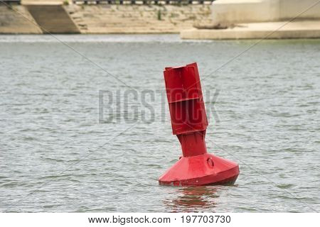 Red Navigation Buoy Floating On The River