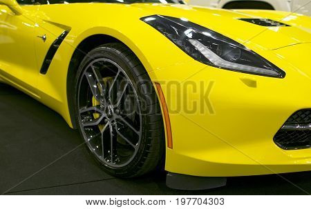 Sankt-Petersburg Russia July 21 2017: Front view of a yellow Chevrolet Corvette Z06. Car exterior details. Photo Taken on Royal Auto Show July 21