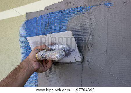 Spreading Mortar On Mesh Of Styrofoam Insulation Wall 2