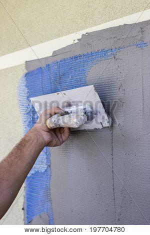 Spreading Mortar On Mesh Of Styrofoam Insulation Wall 3