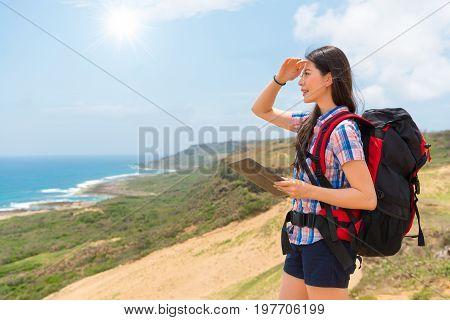 Female Hiking Backpacker Using Mobile Computer