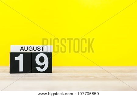 August 19th. Image of august 19, calendar on yellow background with empty space for text. Summer time.