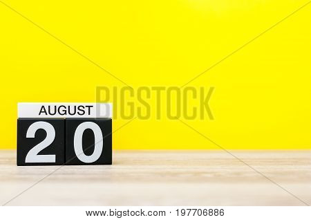 August 20th. Image of august 20, calendar on yellow background with empty space for text. Summer time.
