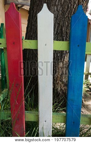 Colorful Picket Fence Painted In Red, White And Blue