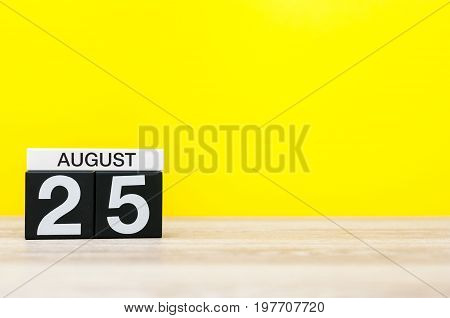 August 25th. Image of august 25, calendar on yellow background with empty space for text. Summer time.