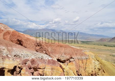 Slope of red and yellow hill. Martian landscape of Altai mountains. Altay Republic Russia.