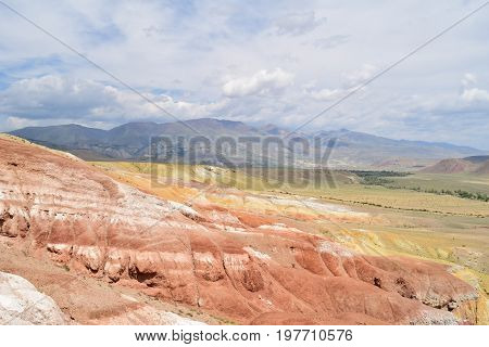 Slopes of red and yellow hills. Martian landscape of Altai mountains. Altay Republic Russia.