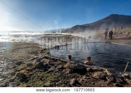 Uyuni, Bolivia- March 27, 2017: Tourist take a bath in hot springs at natural reserve Eduardo Avoroa Bolivia