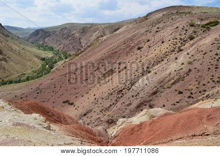 Ravine between multicolor hills in Altai mountains. Altay Republic Russia.