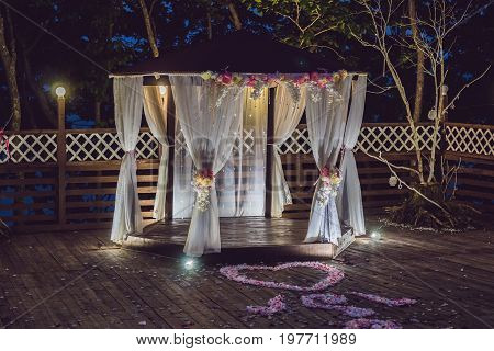 Night Wedding Ceremony. Decorations For Wedding Ceremony Arch And Lamps In The Night Forest