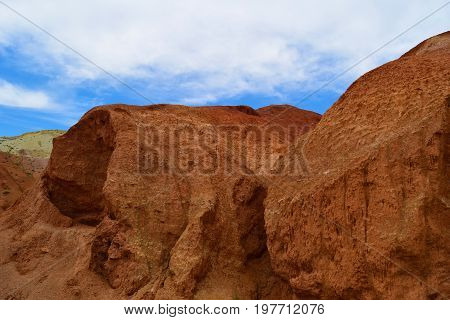 Red cliff in Altai mountains. Martian landscape. Altay Republic Siberia Russia.