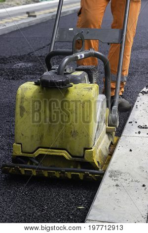 Close Up Of Vibrating Compactor Plate In Action 2