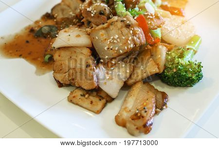 Delicious Chinese fusion spicy roasted pork belly mixed with vegetable and special homemade sauce