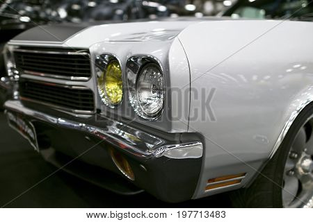 Front view of a old retro car. Car exterior details. Headlight of a retro car. The front lights of the car