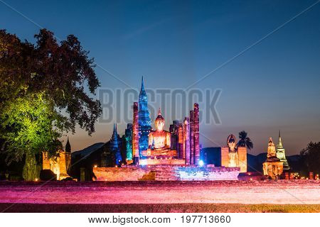 Colorful light up buddha statue at wat mahathat temple in sukhothai world heritage thailand