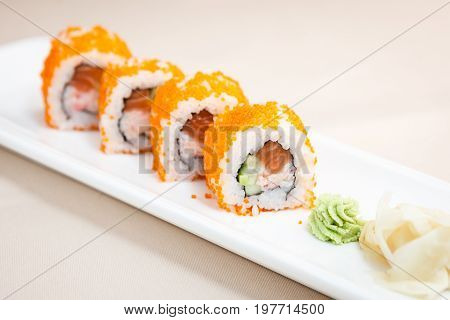Flying fish roe maki with wasabi and ginger