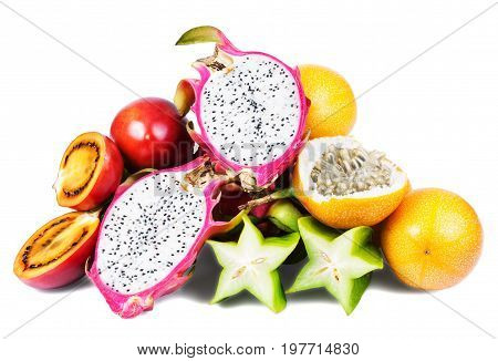 Isolated tropical fruits. Dragon fruit, tamarillo, passion fruit, star fruit.