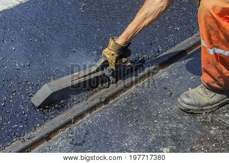 Worker Using A Special Tool To Spread Mastic Asphalt 3