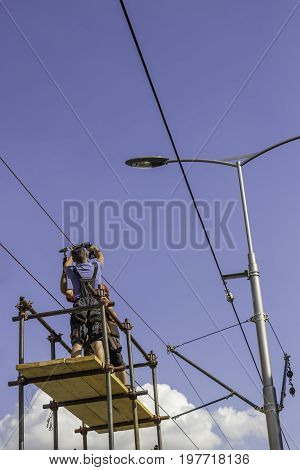 Workers Installing The Overhead Power Line Equipment 2