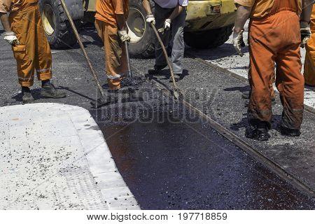 Workers Using A Asphalt Tool To Spread Mastic Asphalt 3