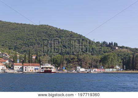 LEPETANI MONTENEGRO - JUNE 27 2017: The Lepetani-Kamenari ferry is the only domestic ferry service in Montenegro passing through the Verige Strait.