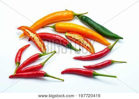 Mix color Red green yellow sliced chilli and bird's eye pepper isolated on white background