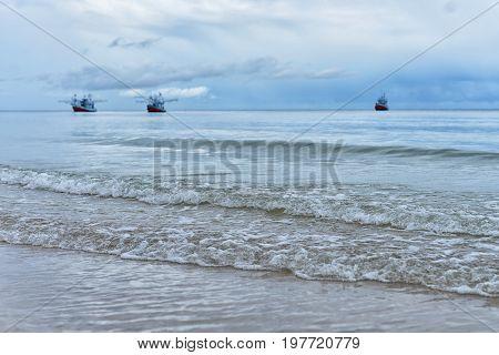 At dawn Beach Fishing boats returning to shore