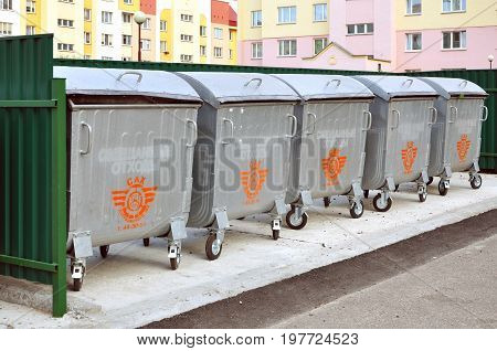 Grodno, Belarus - July 18, 2017: Many metallic garbage containers for collecting glass paper plastic and mixed waste in modern residential district.