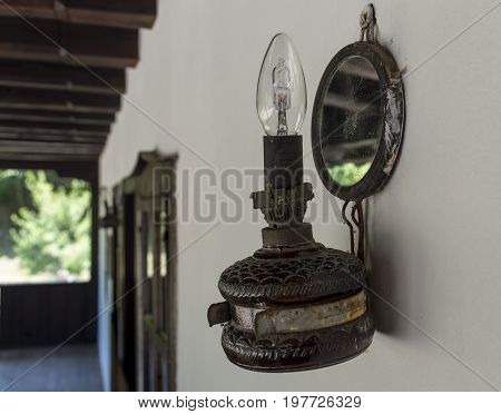 Antique old lamp on the wall in the balcony.