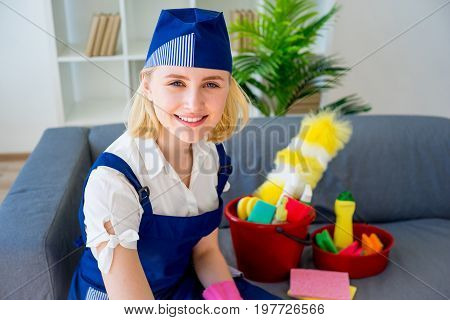 Maid of cleaning service cleaning up a house