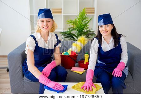 Maids of cleaning service cleaning up a house