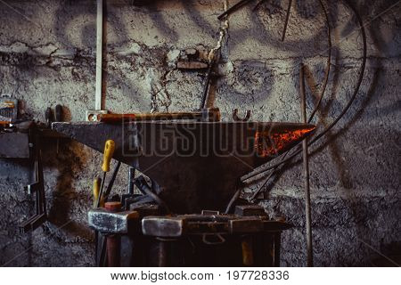 Tools - hammer and anvil used by a blacksmith in old shop