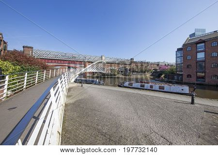 Wide view of Castlefield Basin Manchester's industrial heritage heart on a sunny morning