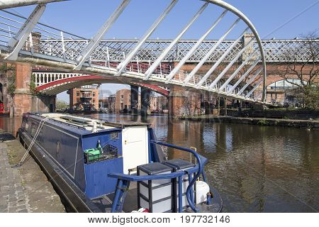 View of Castlefield Basin & the Merchant's Bridge with the historical rail bridge and Potato Wharf in the background