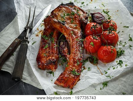Pork middle chop roast with sweet and sour souce, baked tomatoes and red onion.