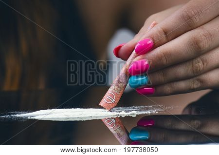 Drug addict woman.. Young woman using a drug. Addcition and drugs concept. Crime and desease.