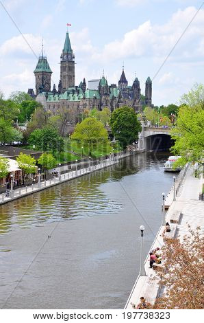 Canada Parliament Buildings and Rideau Canal, Ottawa, Ontario, Canada. Rideau Canal was registered as a UNESCO World Heritage Site for the reason of the oldest continuously operated canal system in North American.