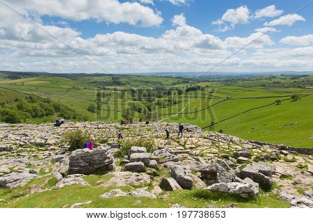 YORKSHIRE DALES, ENGLAND, UK-JUNE 7TH 2017: Beautiful sunshine and fine weather was enjoyed by visitors to Malham Cove in the Yorkshire Dales National Park, Yorkshire on Wednesday 7th June 2017
