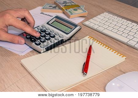 Close up view of bookkeeper or financial inspector hands making report calculating or checking balance. Home finances investment economy saving money - color / Old Polaroid