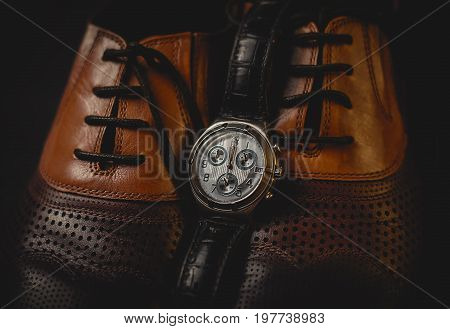 stylish Male shoes and watch over black