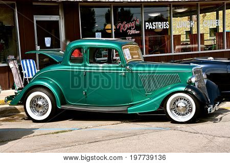 CASSELTON, NORTH DAKOTA, July 27, 2017: The annual Casselton Car Show which occurs the last Thursday of July features classic vehicles such as the  restored Ford Coupe with 5 windows.
