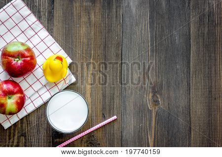 Preparing quick lunch for schoolchild. Fruits on dark wooden table background top view copyspace.