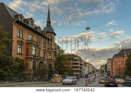 Evening view with an beautiful blue sky on a street in Munich on September 27 2015 in Bavaria Germany.