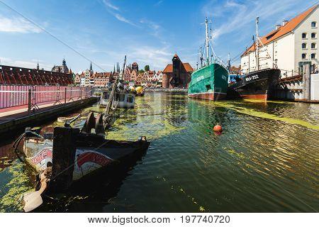 Gdansk Poland - July 22 2017: Sunken ship in harbor of Gdansk in summer