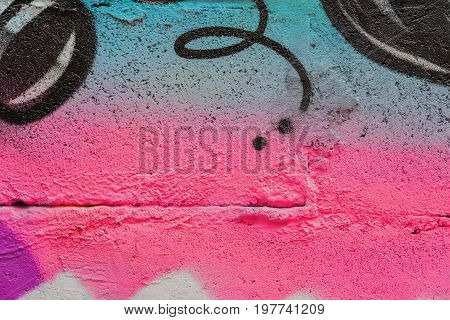 Abstract fragment of wall with detal of graffiti, old chipped paint, scratch, grunge texture. Aerosol design, pink and blue shades. Modern background, banner design